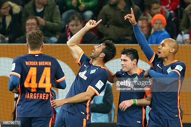 Claudio Pizarro of Bremen celebrate scoring the opening goal with his team mates Zlatko Junuzovic and Theodor Gebre Selassi during the Bundesliga...