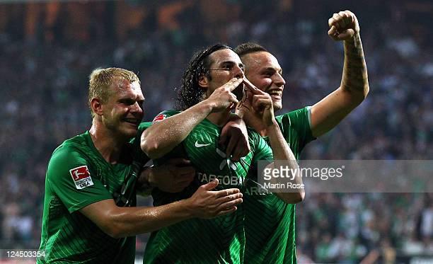 Claudio Pizarro of Bremen celebrates after he scores his team's 2nd goal during the Bundesliga match between Werder Bremen and Hamburger SV at Weser...