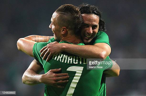 Claudio Pizarro of Bremen celebrates after he scores his team's 2nd goal during the Bundesliga match between Werder Bremen and Hamburger SV at Weser...