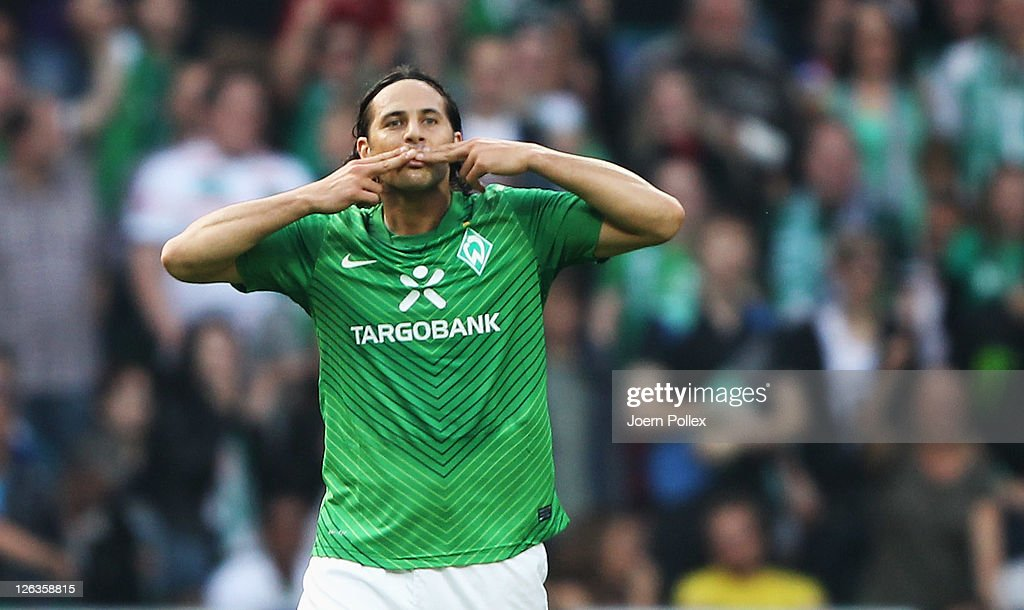 Claudio Pizarro of Bremen celebrates after scoring his team's first goal during the Bundesliga match between Werder Bremen and Hertha BSC Berlin at...