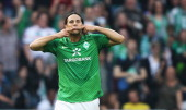 Claudio Pizarro of Bremen celebrates after scoring his team's first goal during the Bundesliga match between Werder Bremen and Hertha BSC Berlin at...