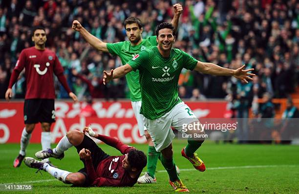 Claudio Pizarro of Bremen celebrates after scoring his teams first goal during the Bundesliga match between SV Werder Bremen and Hannover 96 at Weser...