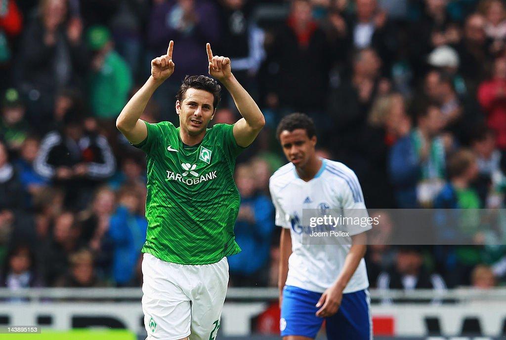 Claudio Pizarro of Bremen celebrates after scoring his team's first goal during the Bundesliga match between SV Werder Bremen and FC Schalke 04 at...