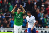 Claudio Pizarro of Bremen celebrates after scoring his team's first goal during the Bundesliga match between SV Werder Bremen and FC Schalke 04 at...