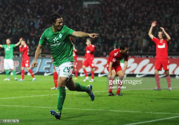 Claudio Pizarro of Bremen celebrates after scoring his team's third goal during the Bundesliga match between Werder Bremen and 1 FC Koeln at Weser...