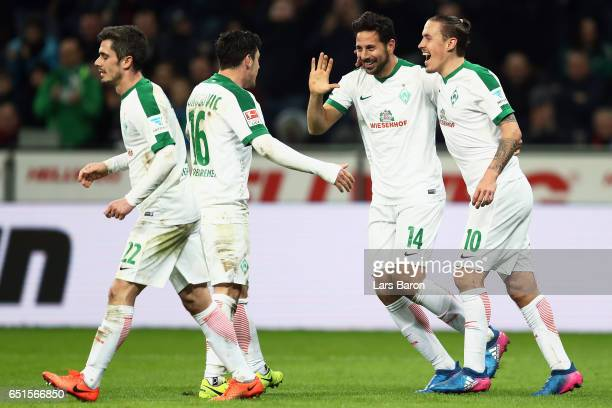 Claudio Pizarro of Bremen celebrates his team's first goal with team mates Fin Bartels Zlatko Junuzovic and Max Kruse during the Bundesliga match...