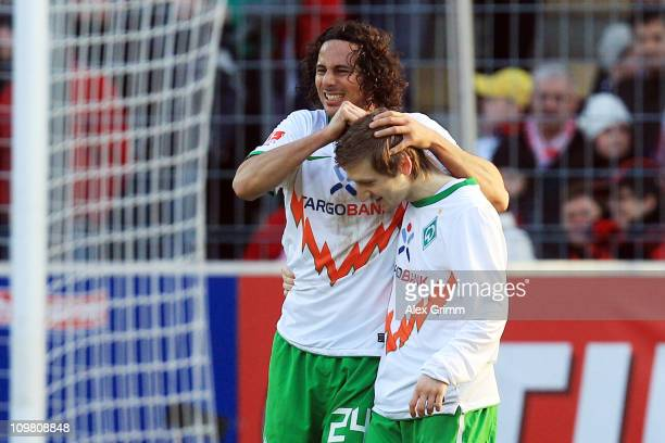 Claudio Pizarro of Bremen celebrates his team's second goal with team mate Marko Marin during the Bundesliga match between SC Freiburg and SV Werder...