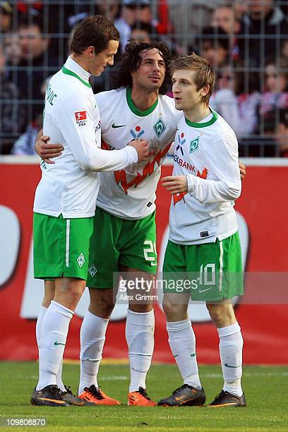 Claudio Pizarro of Bremen celebrates his team's second goal with team mates Marko Marin and Marko Arnautovic during the Bundesliga match between SC...