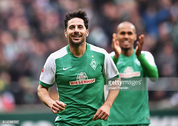 Claudio Pizarro of Bremen celebrates scoring his 100th bundesliga goal during the Bundesliga match between Werder Bremen and Hannover 96 at...