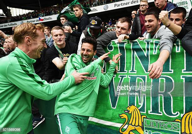 Claudio Pizarro of Bremen celebrates with fans after the Bundesliga match between Werder Bremen and VfL Wolfsburg at Weserstadion on April 16 2016 in...
