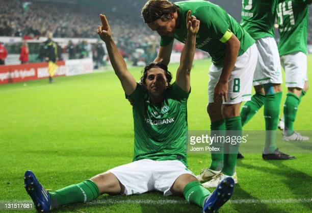 Claudio Pizarro of Bremen celebrates with his team mates after scoring his team's third goal during the Bundesliga match between Werder Bremen and 1...