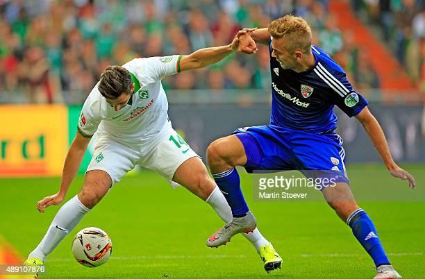 Claudio Pizarro of Bremen challenges Lukas Hinterseer of Ingolstadt during the Bundesliga match between Werder Bremen and FC Ingolstadt at...