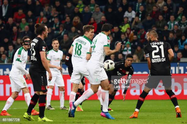 Claudio Pizarro of Bremen deflects the ball after a shot of Robert Bauer to score his team's first goal during the Bundesliga match between Bayer 04...