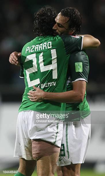 Claudio Pizarro of Bremen embraces Hugo Almeida of Bremen after winning 32 the Bundesliga match between Werder Bremen and Hamburger SV at the Weser...