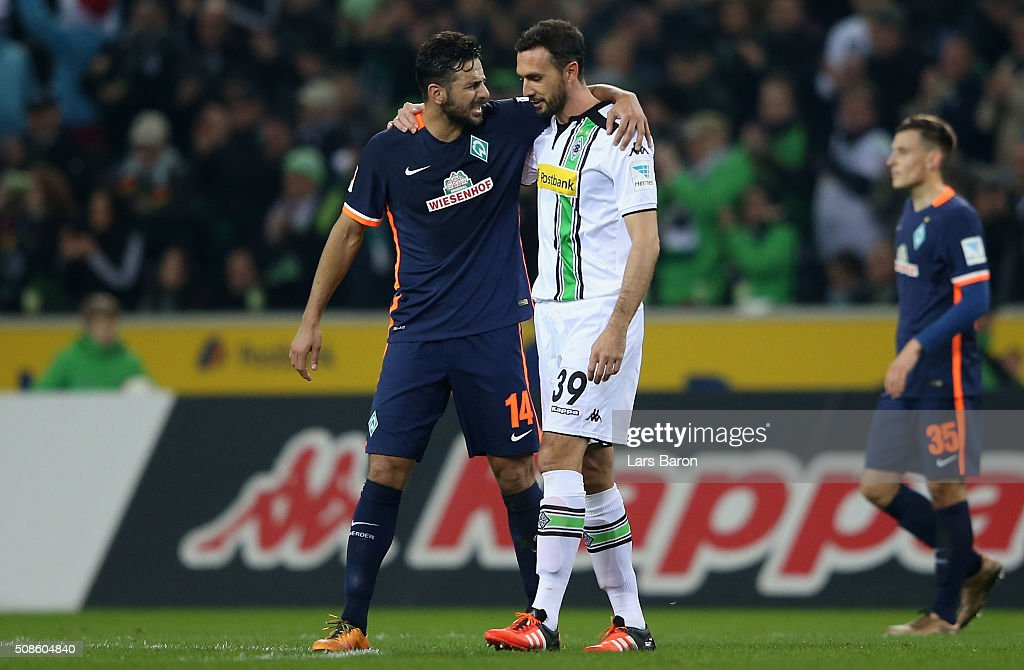 Claudio Pizarro of Bremen hughs Martin Stranzl of Moenchengladbach after the Bundesliga match between Borussia Moenchengladbach and Werder Bremen at...