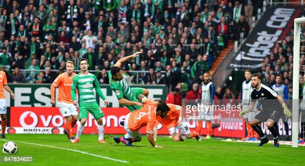 Claudio Pizarro of Bremen is challenged by Aytac Sulu of Darmstadt leading to the penalty during the Bundesliga match between Werder Bremen and SV...