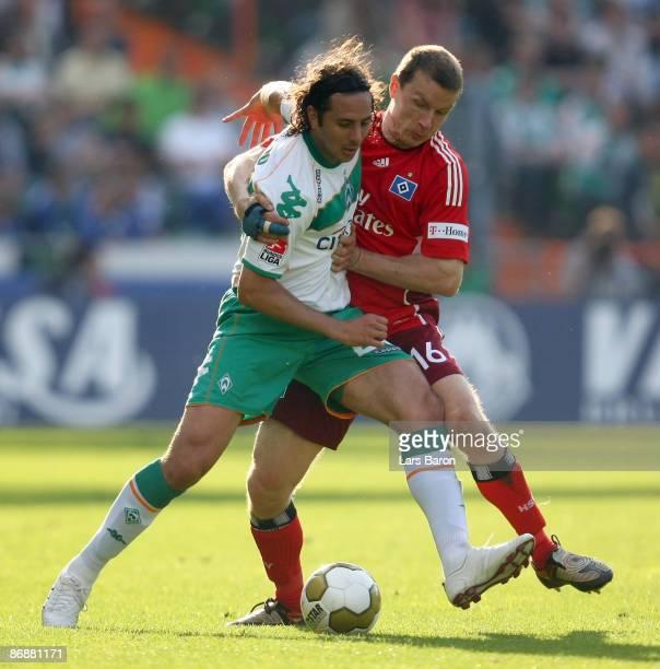 Claudio Pizarro of Bremen is challenged by Michael Gravgaard of Hamburg during the Bundesliga match between Werder Bremen and Hamburger SV at...