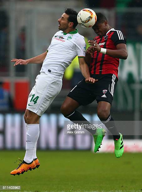 Claudio Pizarro of Bremen jumps for a header with Roger of Ingolstadt during the Bundesliga match between FC Ingolstadt and Werder Bremen at Audi...