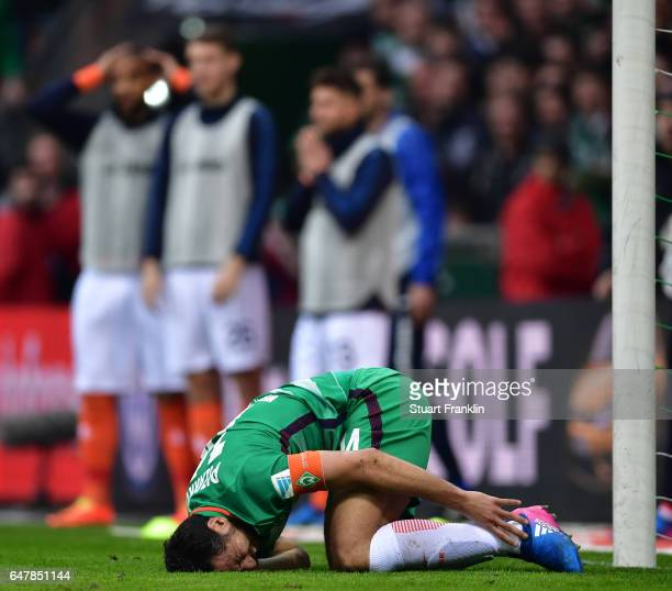 Claudio Pizarro of Bremen lays injured after being challenged by Aytac Sulu of Darmstadt leading to the penalty during the Bundesliga match between...