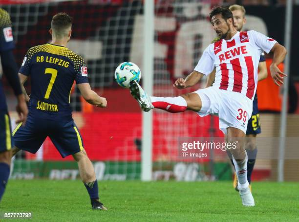 Claudio Pizarro of Koeln and Marcel Sabitzer of Leipzig battle for the ball during the Bundesliga match between 1 FC Koeln and RB Leipzig at...