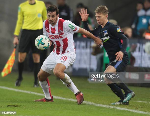 Claudio Pizarro of Koeln and Mitchell Weiser of Hertha BSC Berlin battle for the ball during the Bundesliga match between 1 FC Koeln and Hertha BSC...