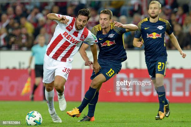 Claudio Pizarro of Koeln Stefan Ilsanker of Leipzig Konrad Laimer of Leipzig battle for the ball during the Bundesliga match between 1 FC Koeln and...