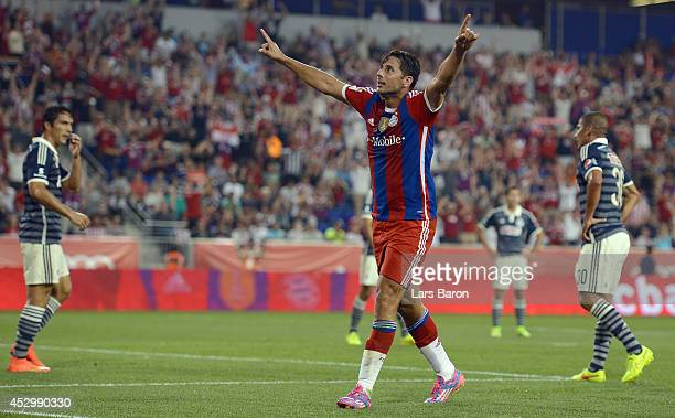 Claudio Pizarro of Muenchen celebrates after scoring his teams first goal during the friendly match between CD Guadalajara and FC Bayern Muenchen at...