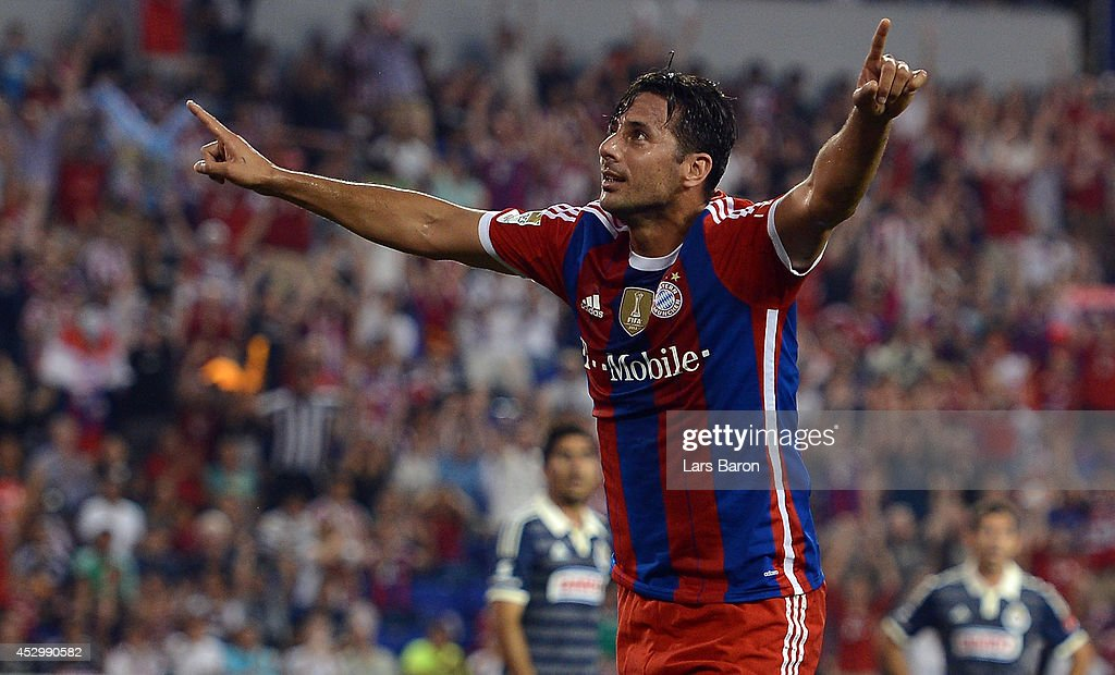 <a gi-track='captionPersonalityLinkClicked' href=/galleries/search?phrase=Claudio+Pizarro&family=editorial&specificpeople=217807 ng-click='$event.stopPropagation()'>Claudio Pizarro</a> of Muenchen celebrates after scoring his teams first goal during the friendly match between CD Guadalajara and FC Bayern Muenchen at Red Bull Arena on July 31, 2014 in New York, United States.