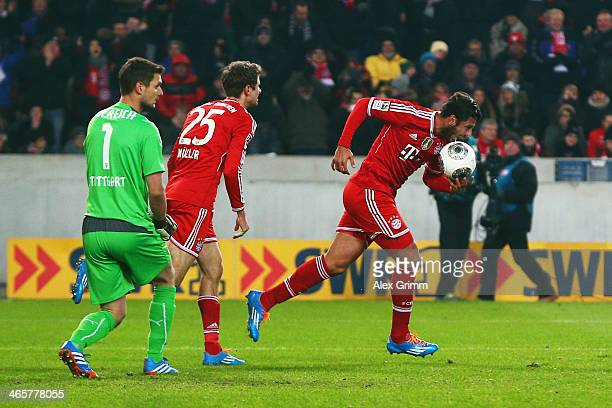Claudio Pizarro of Muenchen celebrates his team's first goal with team mate Thomas Mueller as goalkeeper Sven Ulreich of Stuttgart reacts during the...