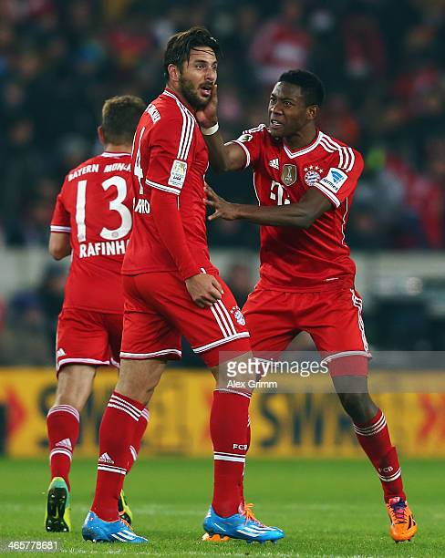 Claudio Pizarro of Muenchen celebrates his team's first goal with team mate David Alaba during the Bundesliga match between VfB Stuttgart and FC...