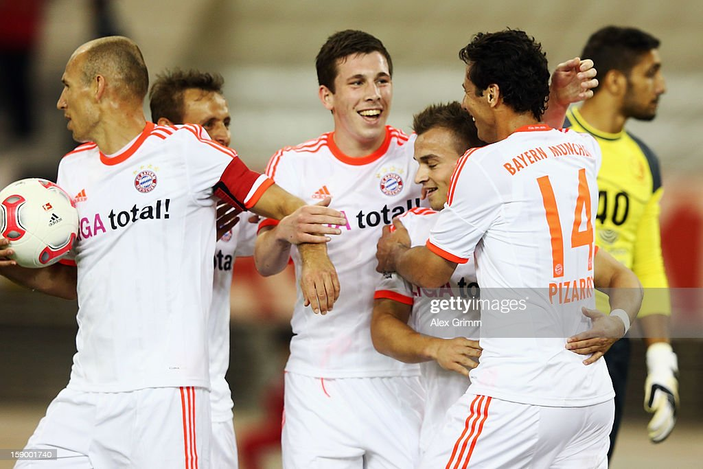 <a gi-track='captionPersonalityLinkClicked' href=/galleries/search?phrase=Claudio+Pizarro&family=editorial&specificpeople=217807 ng-click='$event.stopPropagation()'>Claudio Pizarro</a> of Muenchen celebrates his team's third goal with team mates during the international friendly match between Lekhwiya Sports Club and FC Bayern Muenchen at Khalifa International Stadium on January 5, 2013 in Doha, Qatar.