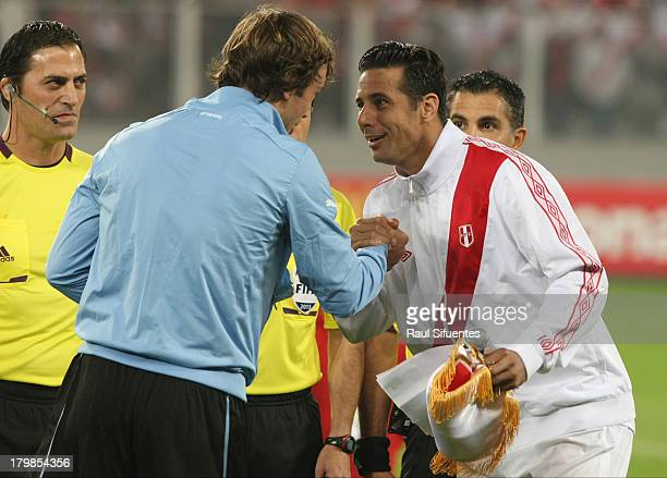 Claudio Pizarro of Peru and Diego Lugano of Uruguay before a match between Peru and Uruguay as part of the 15th round of the South American...