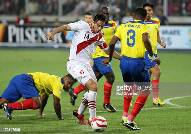 Claudio Pizarro of Peru fights for the ball with Frickson Erazo of Ecuador during a match between Peru and Ecuador as part of the 13th round of the...