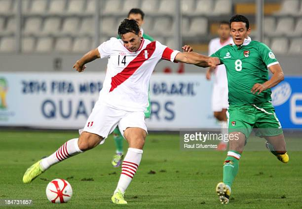 Claudio Pizarro of Peru fights for the ball with Jose Luis Chavez of Bolivia during a match between Peru and Bolivia as part of the 18th round of the...
