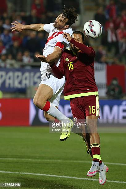 Claudio Pizarro of Peru goes for a header with Roberto Rosales of Venezuela during the 2015 Copa America Chile Group C match between Peru and...