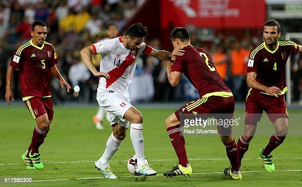Claudio Pizarro of Peru struggles for the ball with Wilker Angel of Venezuela during a match between Peru and Venezuela as part of FIFA 2018 World...