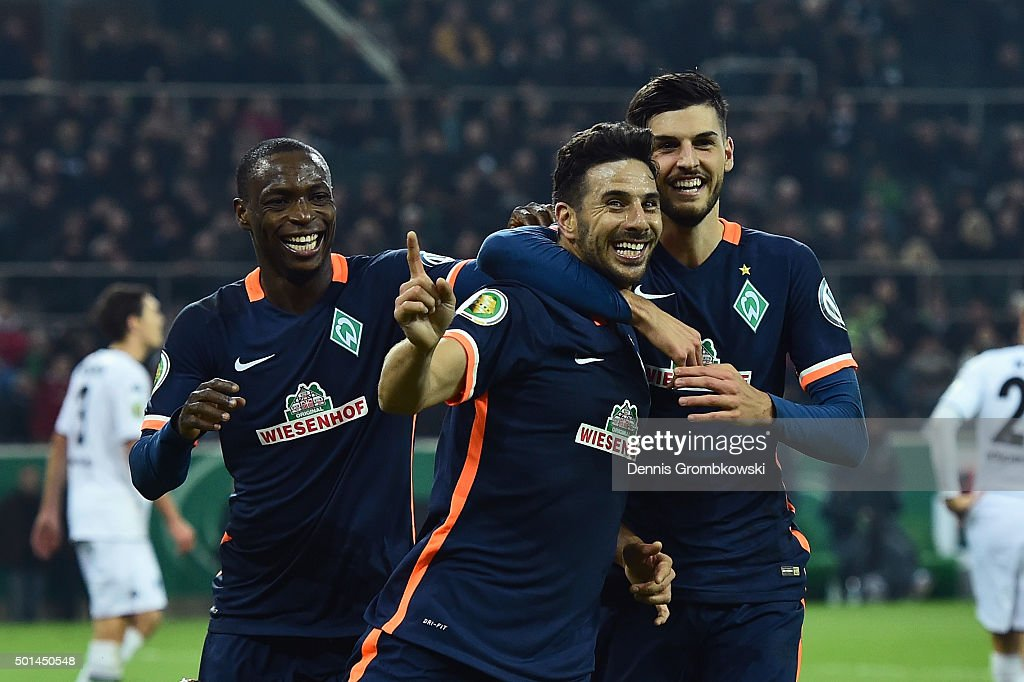 Claudio Pizarro of Werder Bremen celebrates with team mates as he scores the third goal during the DFB Cup Round of 16 match between Borussia...