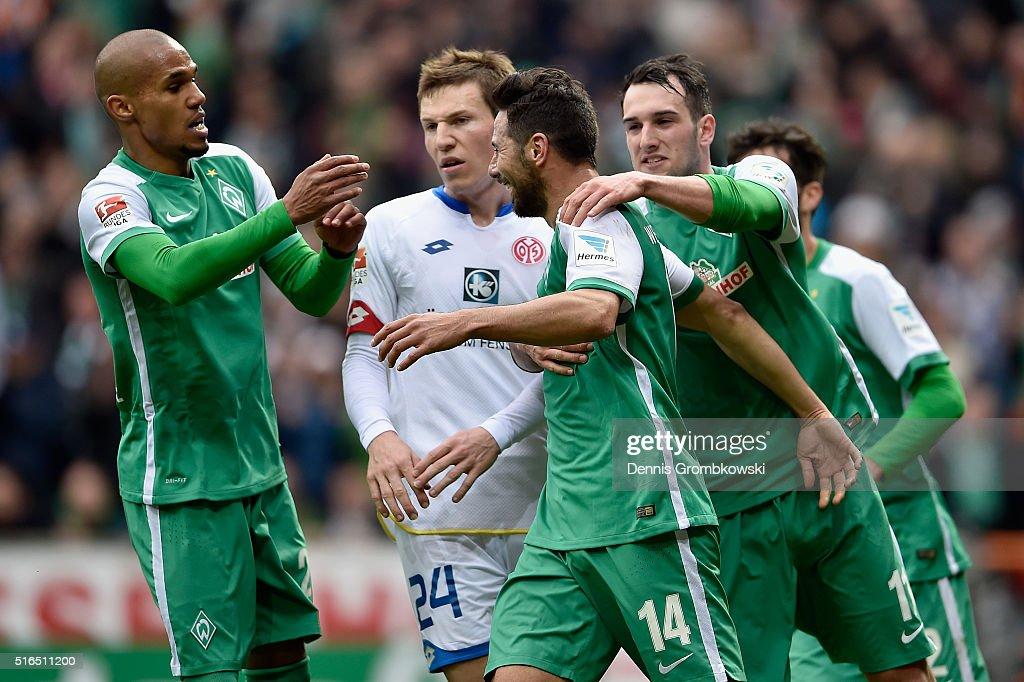 Claudio Pizarro of Werder Bremen celebrates with team mates as he scores their first goal during the Bundesliga match between Werder Bremen and 1 FSV...