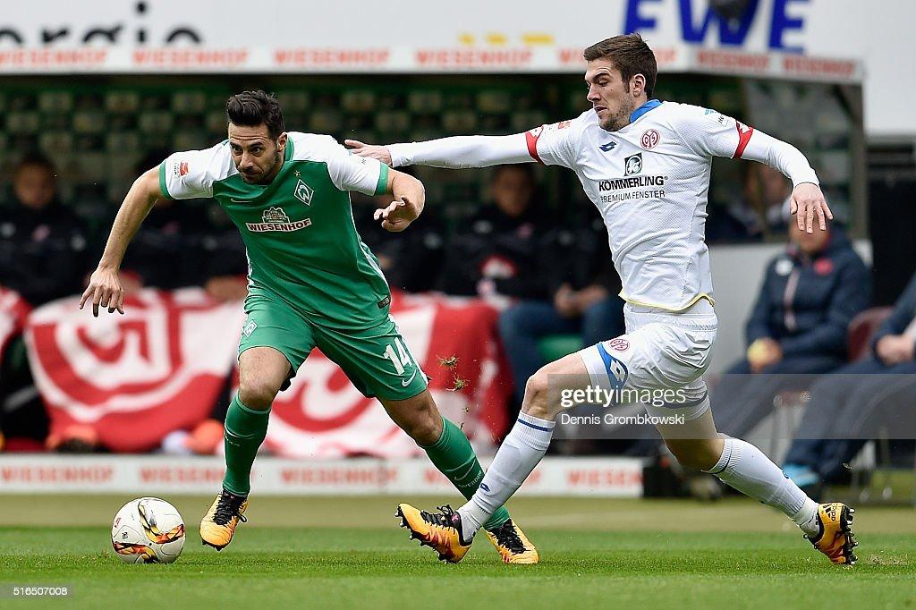 Claudio Pizarro of Werder Bremen is chased by Stefan Bell of 1 FSV Mainz 05 during the Bundesliga match between Werder Bremen and 1 FSV Mainz 05 at...
