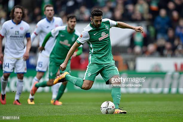 Claudio Pizarro of Werder Bremen scores their first goal from a penalty during the Bundesliga match between Werder Bremen and 1 FSV Mainz 05 at...