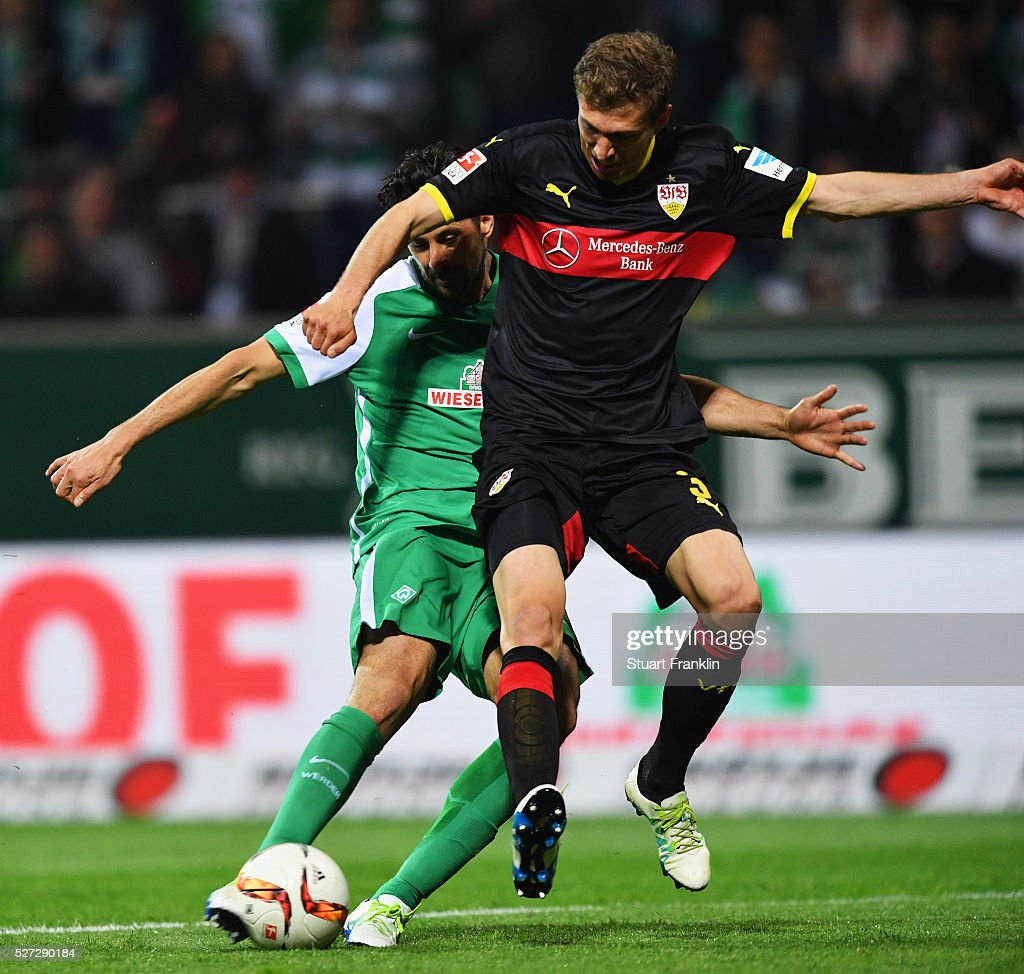 Claudio Pizarro of Werder Bremen scores their fourth goal as Daniel Schwaab of Stuttgart challenges during the Bundesliga match between Werder Bremen and VfB Stuttgart at Weserstadion on May 2, 2016 in Bremen, Germany.
