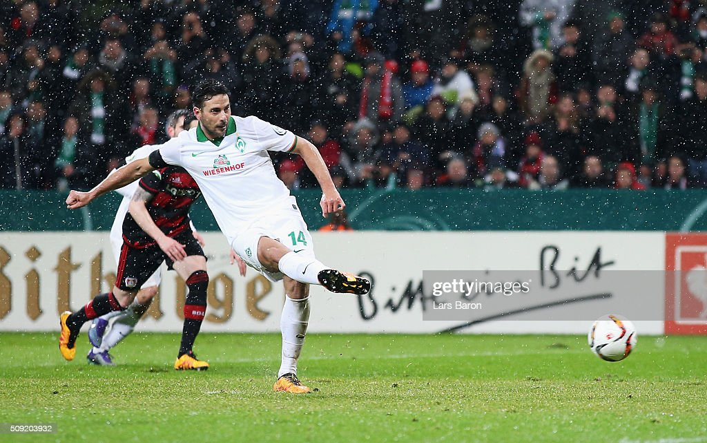 Claudio Pizarro of Werder Bremen scores their second goal from the penalty spot during the DFB Cup Quarter Final match between Bayer Leverkusen and...