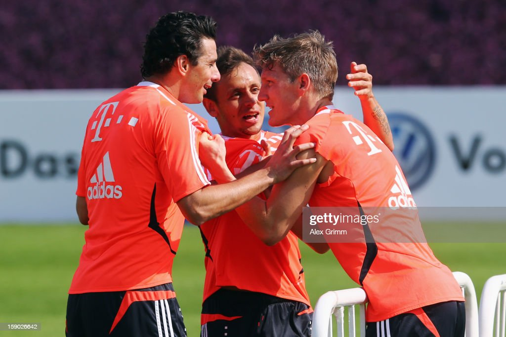 Claudio Pizarro, Rafinha and Bastian Schweinsteiger (L-R) discuss during a Bayern Muenchen training session at the ASPIRE Academy for Sports Excellence on January 6, 2013 in Doha, Qatar.
