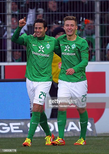 Claudio Pizzaro celebrates his goal with Tom Trybull of Bremen during the Bundesliga match between SC Freiburg and Werder Bremen at Mage Solar...
