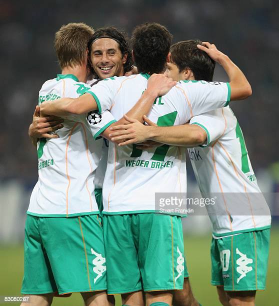 Claudio Pizzaro of Bremen celebrates his goal with Markus Rosenberg Mesut Ozil and Diego during the UEFA Champions League Group B first leg match...