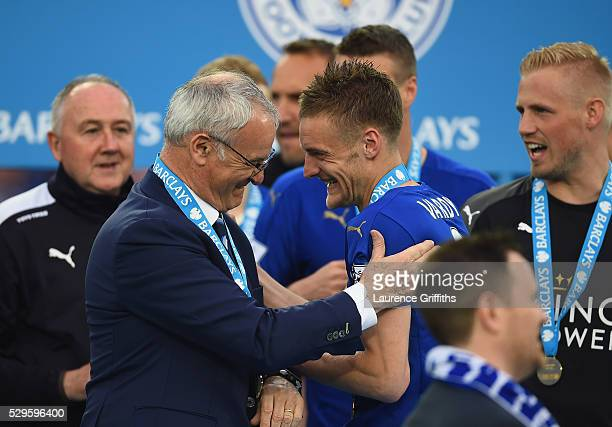 Claudio Ranieri and Jamie Vardy of Leicester City share a joke during the Barclays Premier League match between Leicester City and Everton at The...