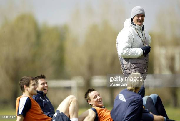 Claudio Ranieri Chelsea manager jokes with Joe Cole Frank Lampard and Captain John Terry during Chelsea team training prior to the game against...