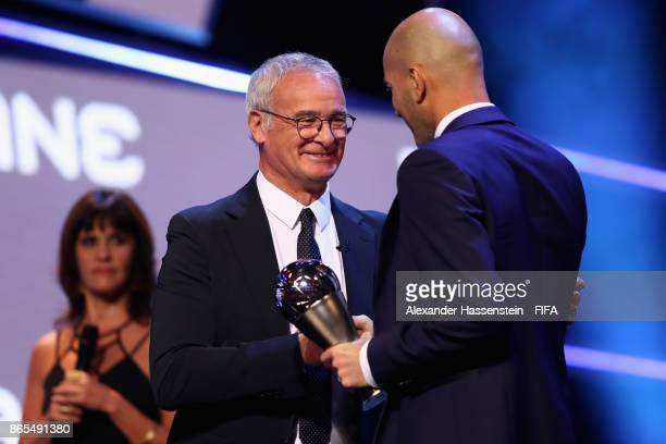 Claudio Ranieri hands over the Best Mens Coach award to Zinedine Zidane of France and Real Madrid CF during The Best FIFA Football Awards at The...