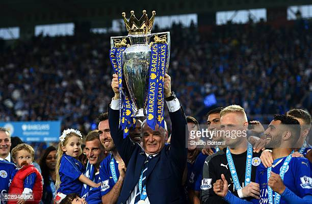Claudio Ranieri lifts the Premier League Trophy as players and staffs celebrate the season champions after the Barclays Premier League match between...