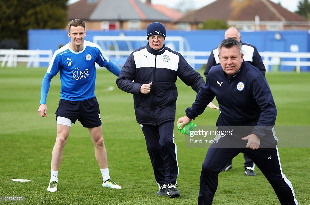 Claudio Ranieri, manager of Leicester City and Andy King (L) take part during a Leicester City training session at Belvoir Drive Training Ground on May 3, 2016 in Leicester, England.